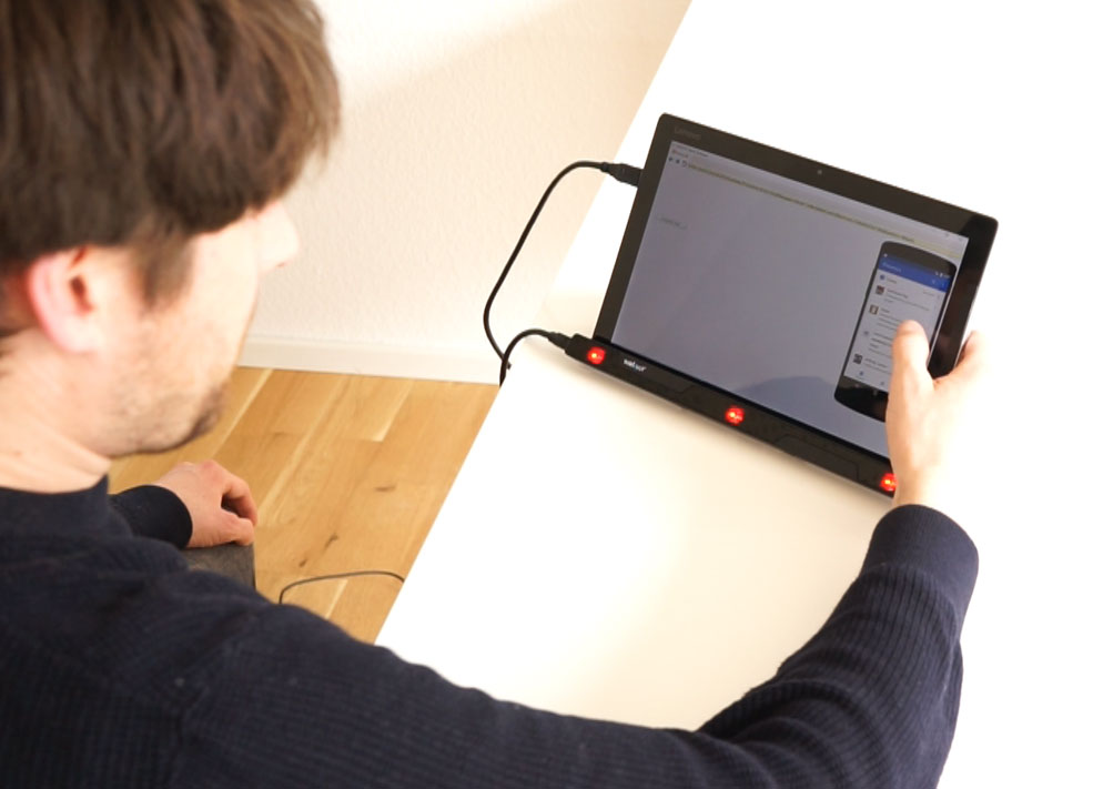 The participant tests an app on the screen while an eye tracker records the eye movements.